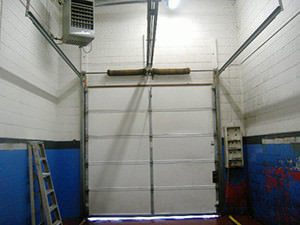 Garage door repair in st charles st louis duncan door for Garage door repair st louis mo